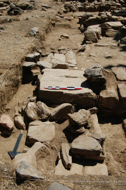 Large square cornerstone; the area was excavated and the fallen stones were removed to reveal the trapped vessels