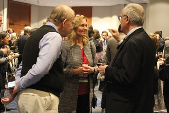 Meeting attendees at the opening night reception