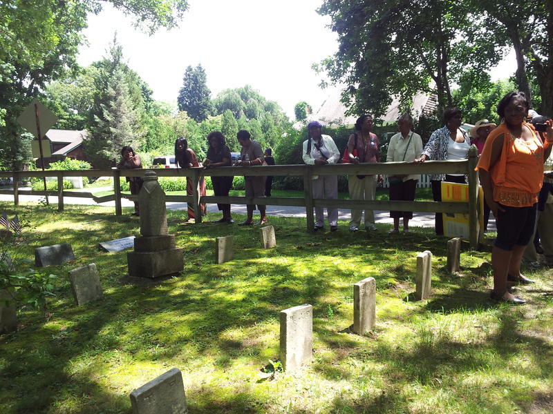 Visitors tour the St. David AME Zion Church Cemetery at Sag Harbor.