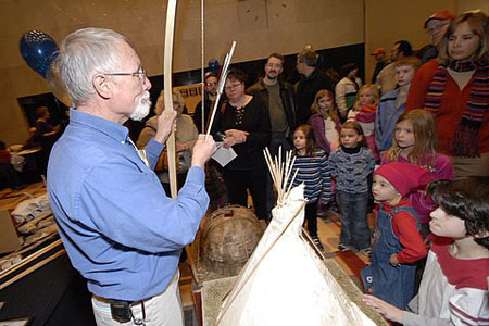 Exhibitor demonstrates bow-and-arrow at the 2009 Archaeology Fair.