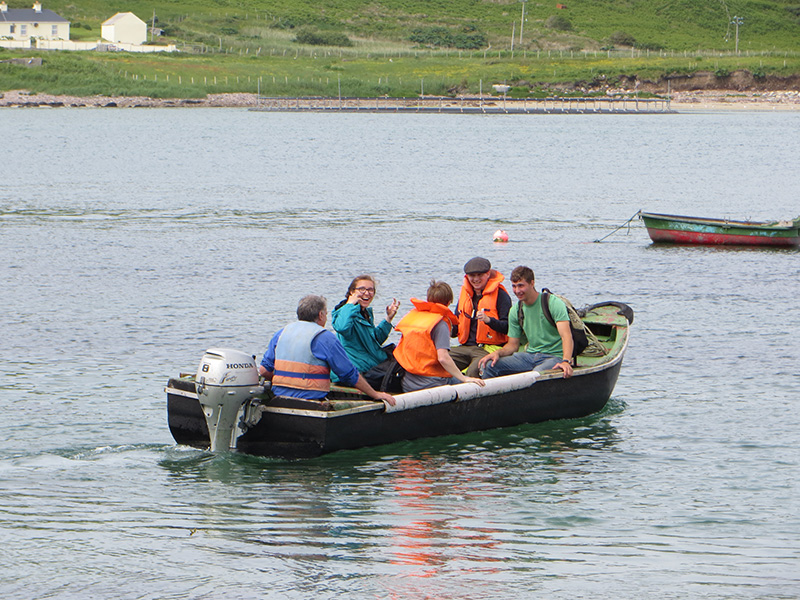Students traveling to Achillbeg in a Currach
