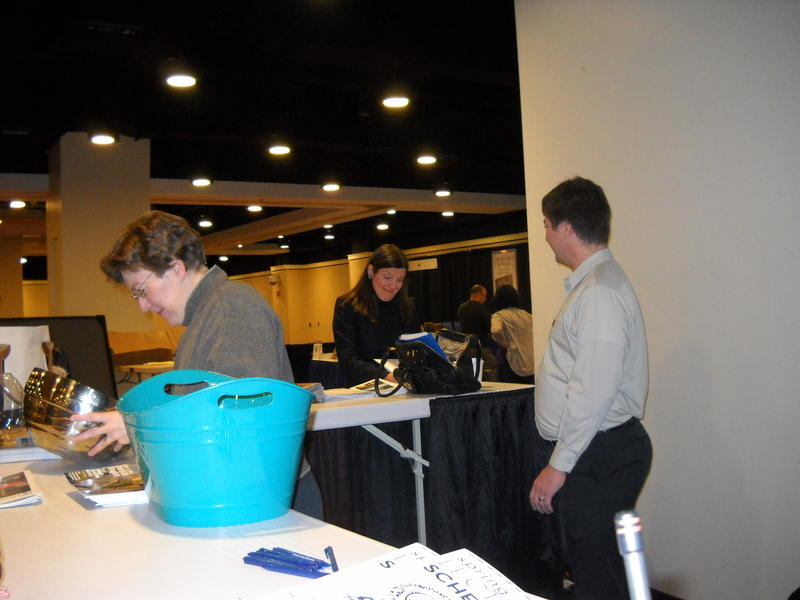 AIA Staff Readies the Kiosk in the Exhibit Hall