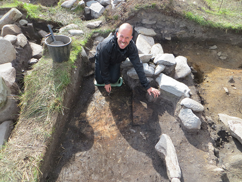 Andrea excavating the hearths in the interior of the inner building