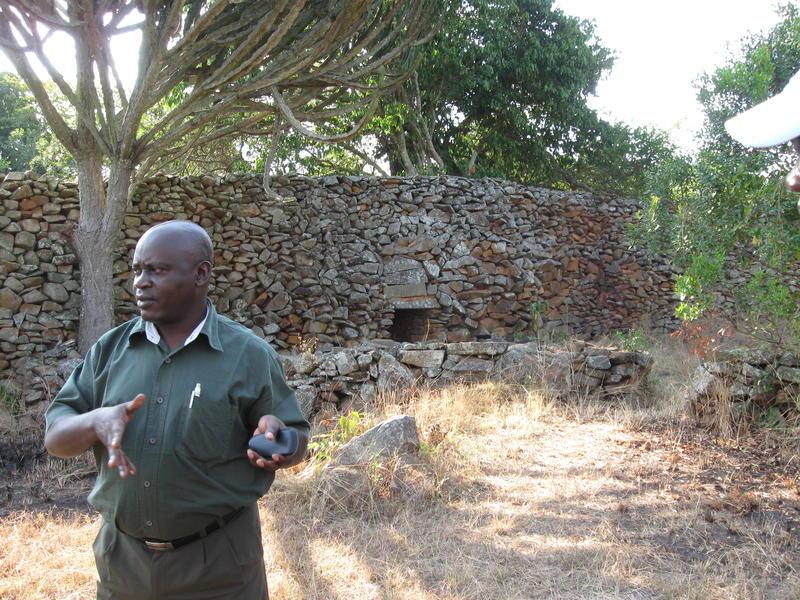 Co-project director Dr. Onjala at the workshop inside the walls of the site, explaining damage from vegetation