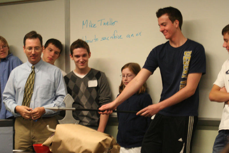 Students at Apples + Archaeology learn how to sacrifice an ox (photo courtesy AIA Central Arizona Society)