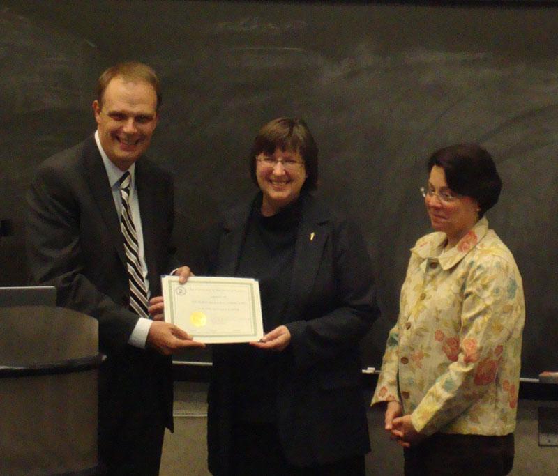 AIA's CEO Peter Herdrich congratulates Hartford Society President Martha Risser (center) and Secretary-Treasurer Karen Menko on the Hartford Society's 100th year.
