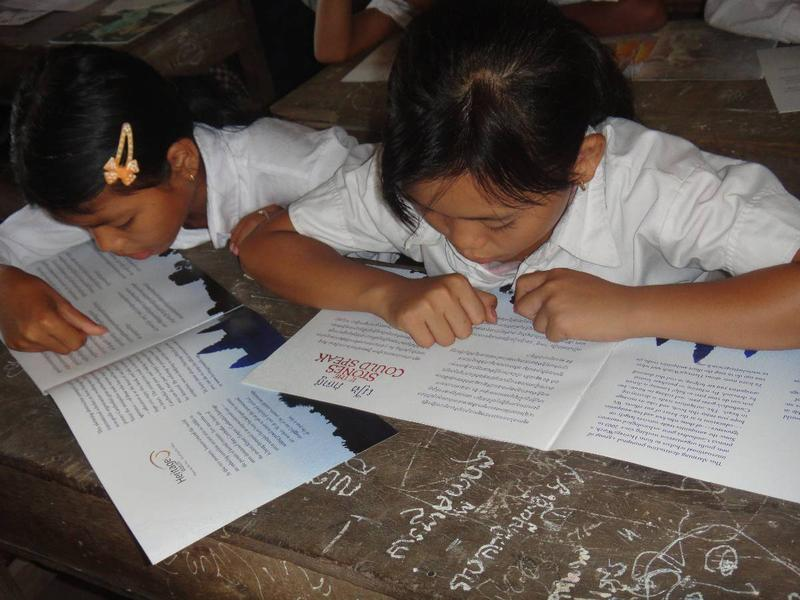 School children learning about Banteay Chhmar from storybooks created by the program.