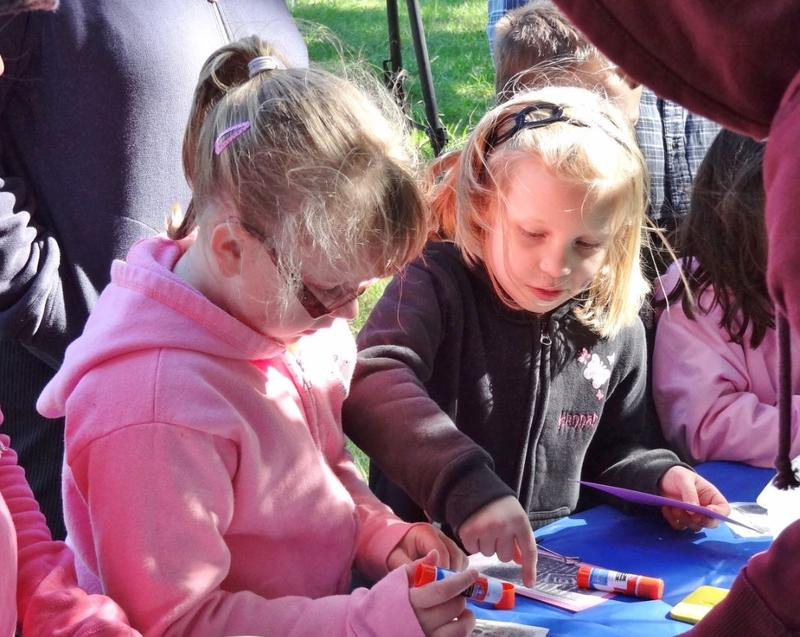 Elizabeth Crawford and Hannah Preus participate in one of the many craft activities.