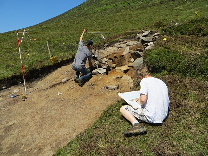 Julien and Jared recording the radial section through the mound in Quadrant 1