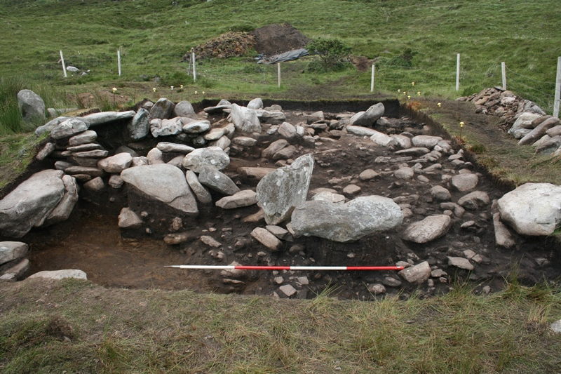 Looking northwards across the site at the extensive spread of soil and stone that was concealed by the rubble layer