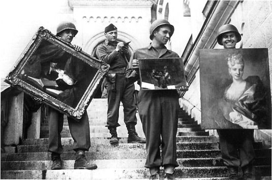 Monuments, Fine Arts, and Archives (MFAA) Officer James Rorimer supervises U.S. soldiers recovering looted paintings from Neuschwanstein Castle in Germany during World War II. The provision in the 1954 Hague Convention to have trained military personnel within a nation's armed forces was inspired by the successful example of the MFAA. (U.S. National Archives and Records Administration)