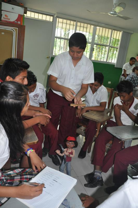 Secondary students in Tahcabo get comfortable operating the marionettes.
