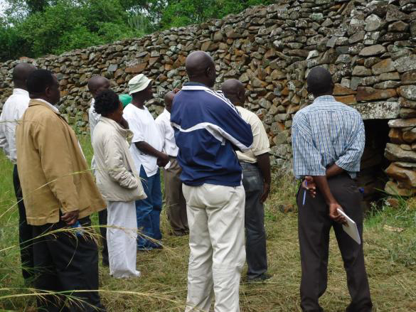 Stakeholders examining a gate at Thimlich Ohinga.