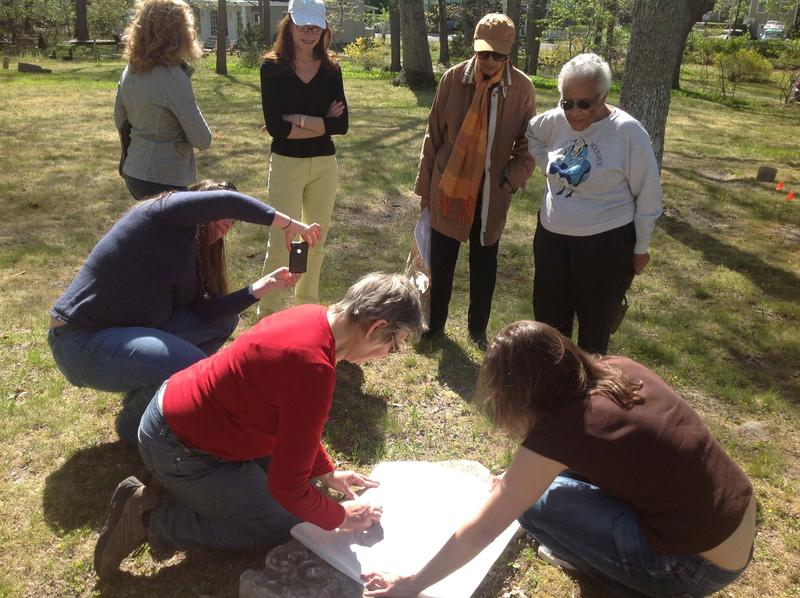 Volunteers try a hand at grave rubbing at the cemetery's Stewardship Spring Cleaning Day (Photo: AIA/ECHS)