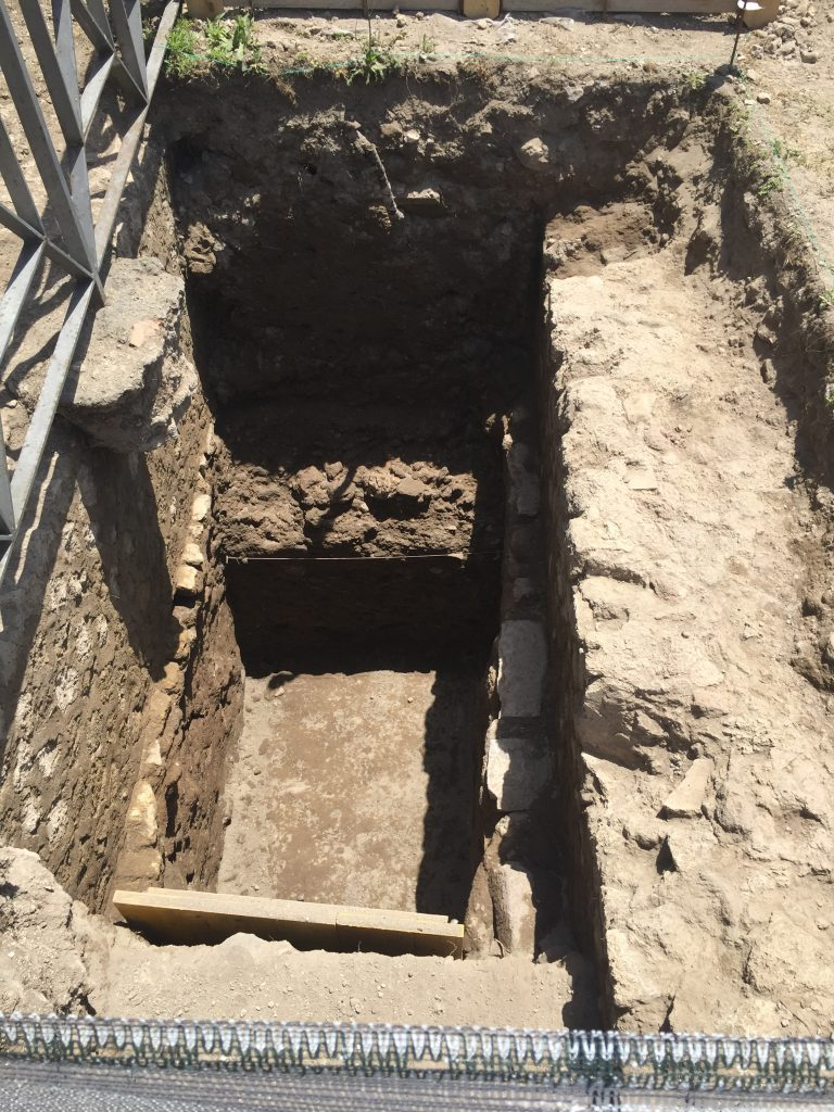 Figure 5: Trench I: sounding from Curti's 2004 excavations in the northeast corner of the sanctuary (note the string on the south section, originally used to attach a measuring tape for drawing).